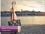 Beautiful tourist with vintage suitcase PowerPoint Templates