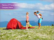Happy family camping in mountains PowerPoint Templates