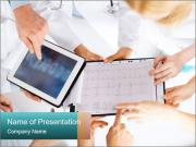 Group of doctors looking at x-ray on tablet pc PowerPoint Template