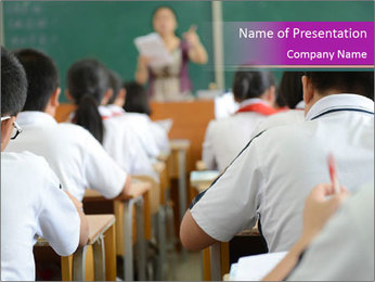 Group of middle school studying in classroom PowerPoint Template - Slide 1