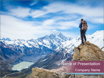 Hiker at the top of a rock PowerPoint Template