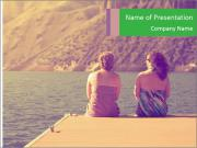Two women sitting on a dock PowerPoint Templates