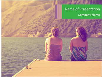 Two women sitting on a dock PowerPoint Templates - Slide 1
