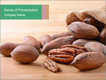 Pecan nuts in a burlap sack bag close up PowerPoint Template - Slide 1