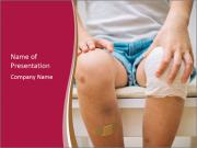 Boy With Injured Knees PowerPoint Templates