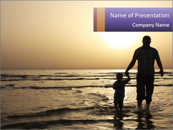 Father and his child by the sea shore, sunset PowerPoint Template - Slide 1
