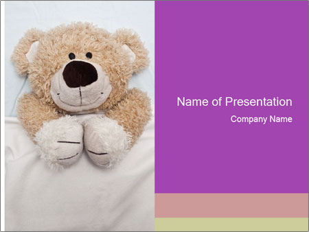An adorable teddy bear laying in bed PowerPoint Templates