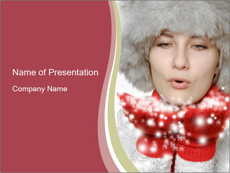 Teenage girl in red gloves and fur hat blowing snow PowerPoint Templates