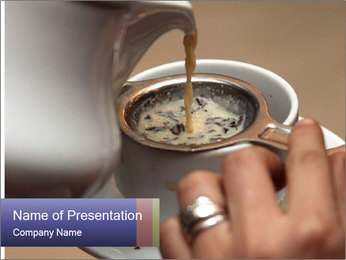 Woman with silver ring pouring tea with milk into cup PowerPoint Template - Slide 1