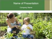 Mother And Son Playing In Garden PowerPoint Templates