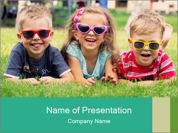 Three baby in sunglasses posing on the grass. PowerPoint Template - Slide 1