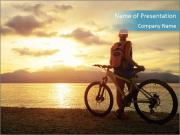 Cyclist Enjoying Sunset PowerPoint Templates