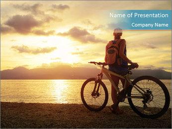 Cyclist Enjoying Sunset PowerPoint Templates - Slide 1