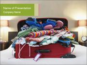 Open suitcase on bed PowerPoint Template