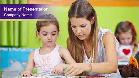 Teacher helping girl painting with watercolor in a kindergarten PowerPoint Template