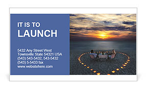 A young couple having dinner in the center of the heart on the beach Business Card Templates
