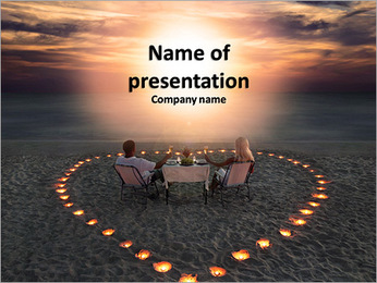 A young couple having dinner in the center of the heart on the beach PowerPoint Template