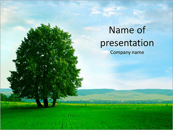 Beautiful green meadow and a very large tree PowerPoint Template