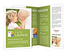 Child kissing belly of pregnant woman against spring green background Brochure Templates