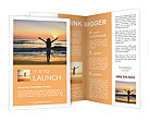 Silhouette of the girl standing at the beach during beautiful sunset. Brochure Templates