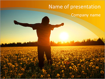 Young man standing on a meadow with dandelions on sunset sky background PowerPoint Template
