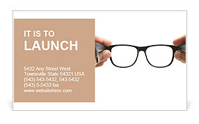 Human hands holding retro style eyeglasses Business Card Template