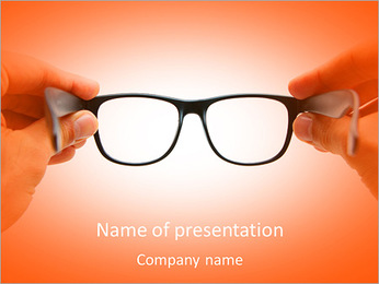 Human hands holding retro style eyeglasses PowerPoint Template