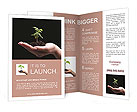 Young plant in woman hand on black background - lit from above, isolated Brochure Templates