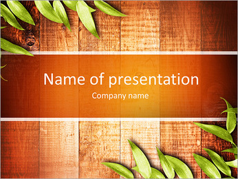 Green leaves on the old wooden background PowerPoint Template