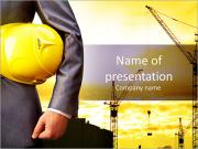 Engineer yellow helmet for workers security on the background of a new high-rise apartment buildings PowerPoint Template