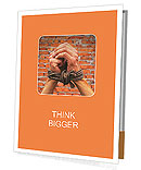 Hands tied up with rope against brick wall Presentation Folder
