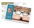 Closeup of reading glasses on the book. shot in the library Postcard Templates