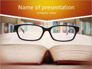 Closeup of reading glasses on the book. shot in the library PowerPoint Templates