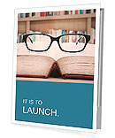 Closeup of reading glasses on the book. shot in the library Presentation Folder