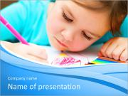 Cute cheerful child drawing using felt-tip pen while sitting at table PowerPoint Templates