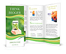 Woman hand holding smart phone against spring green background Brochure Templates