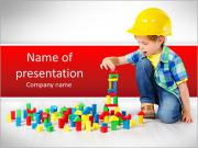 Boy in hard hat playing with blocks: building city. Development and construction concept PowerPoint Templates