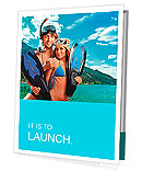 Happy young couple with snorkelling gear standing on a sea beach. Presentation Folder