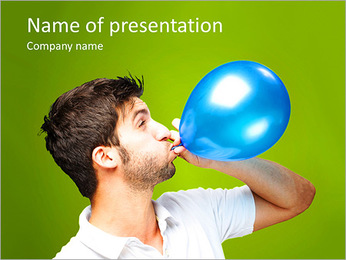 Portrait of young man blowing a balloon over green background PowerPoint Template