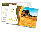 Combine harvester on a wheat field with a blue sky Postcard Template