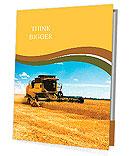 Combine harvester on a wheat field with a blue sky Presentation Folder
