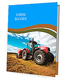 Huge tractor collecting haystack in the field in a nice blue sunny day Presentation Folder