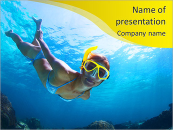 Underwater shoot of a young lady snorkeling and doing skin diving in a tropical sea PowerPoint Template