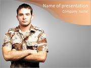 Portrait of a serious young soldier standing against a grey background PowerPoint Templates