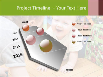 Kids playing on the floor of the childrens room PowerPoint Template - Slide 26