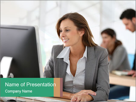 Businesswoman working on desktop computer PowerPoint Template