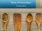 Kitchen wooden utensil of scapula, spoon and fork on wooden table PowerPoint Template