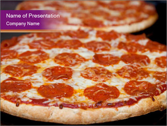 Two pepperoni pizzas in a line on a black stove PowerPoint Template - Slide 1