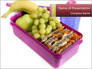 Healthy lunch in a bright pink lunch box PowerPoint Templates