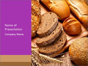 Assortment of baked bread on wood table PowerPoint Template - Slide 1